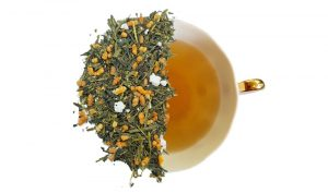 genmaicha Yamasaki green tea loose leaf tea is displayed overtop of a brewed cup of tea