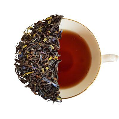 cup of lavender earl grey showing half brewed tea half loose leaf tea