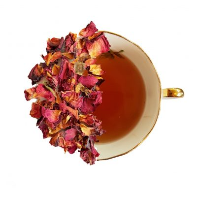 cup of rose petal tea half brewed tea half loose leaf