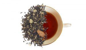 coffee pu-erh loose leaf tea overtop of a cup of brewed tea