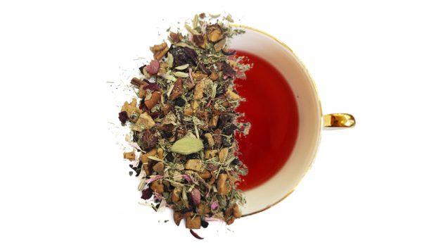 Christmas herbal tea leaves displayed overtop of a steeped cup of tea