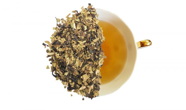 roasted mate chai tea leaves overtop of a brewed cup of tea