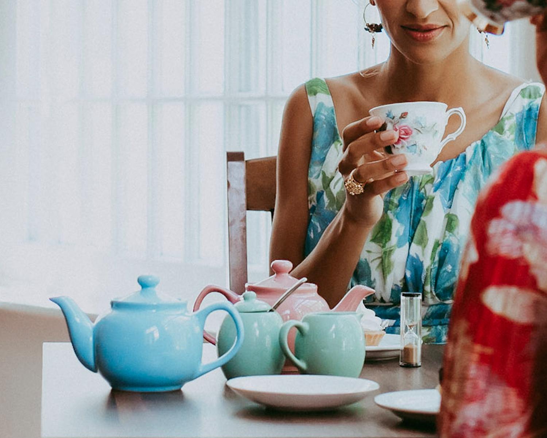 Woman drinking loose leaf tea from Edmonton tea shop Vintage Fork