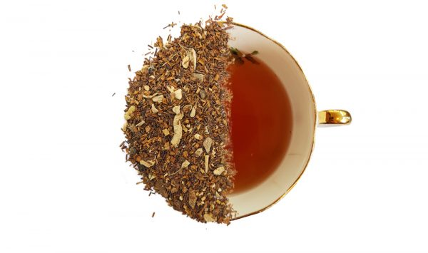 rooibos masala chai tea leaves displayed over a brewed cup of tea